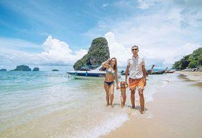 a family on a beach enjoying the krabi 4 island tour