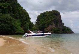 a speedboat moored on a sandy island beach near krabi thailand