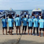 photo of boat crew team on beach at ao nang