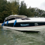 photo of tour speedboat moored at bamboo island near phi phi krabi