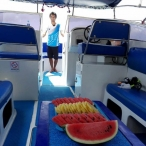 photo of speedboat interior with tropical fruit and boat crew