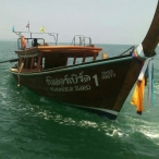 picture of wooden longtailboat in krabi