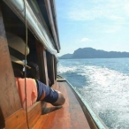 picture fro a longtailboat on the ocean near ao nang thailand