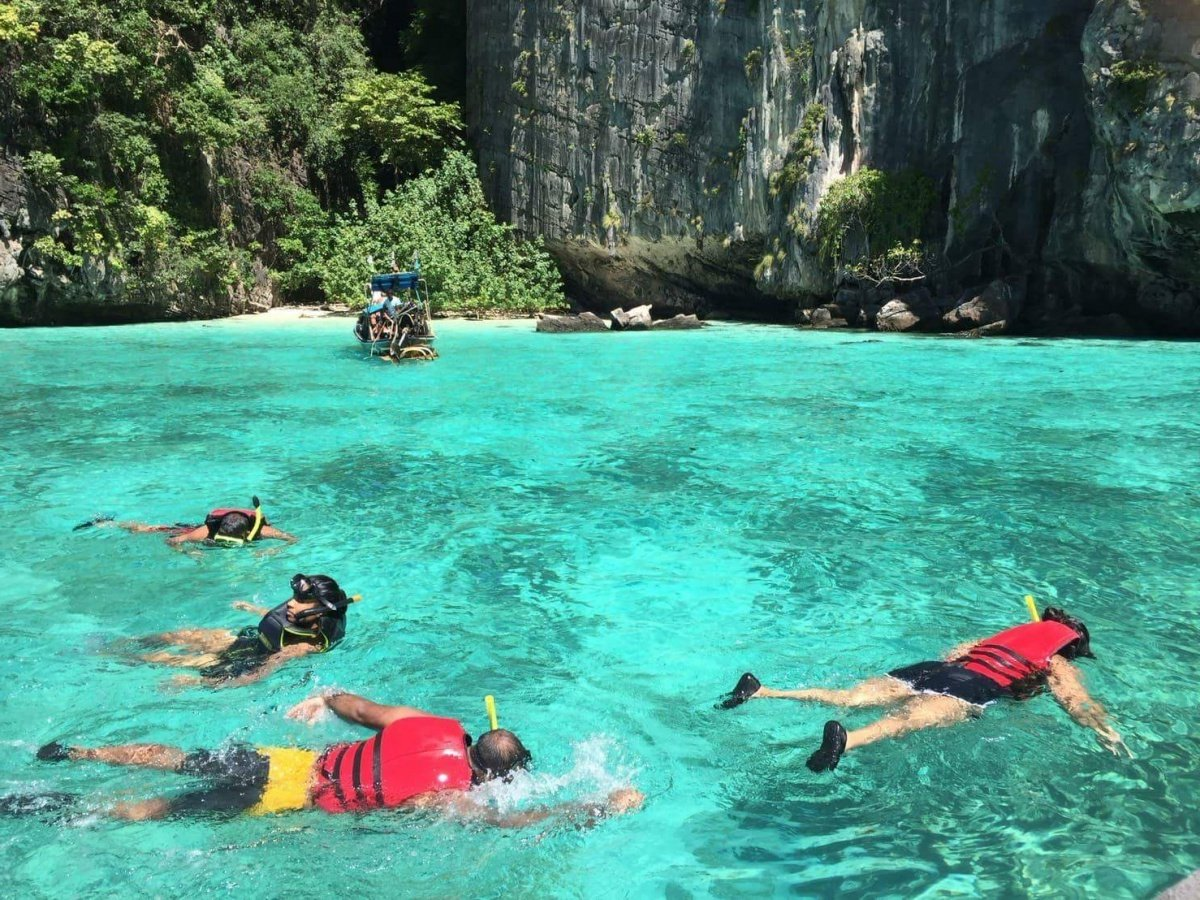customers snorkeling from private speedboat at phi phi islands