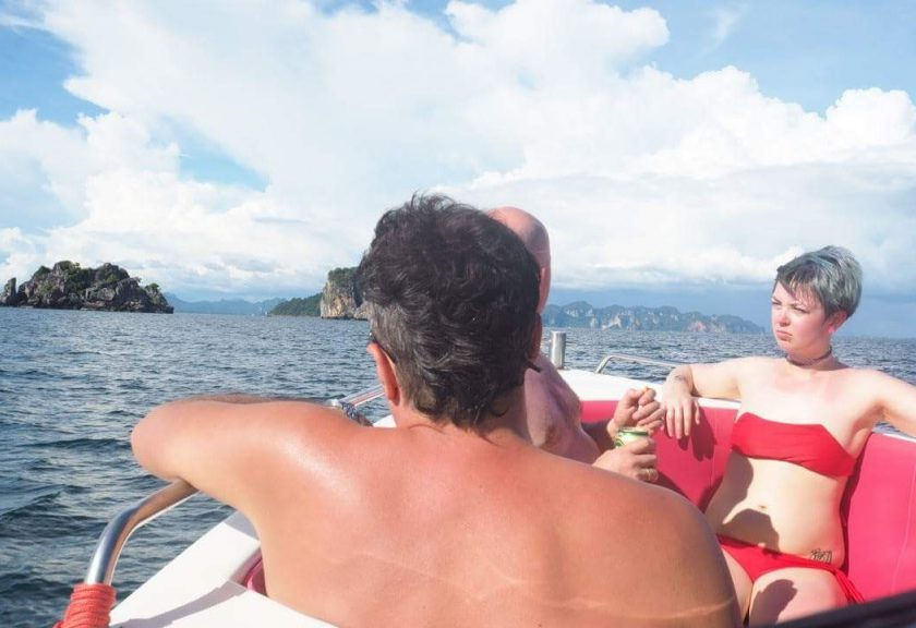 friends on vacation on a private speedboat rental boat to koh yao noi koh + yao yai islands