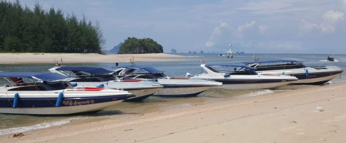 Five speedboats rest on sand at Ao Nang Krabi